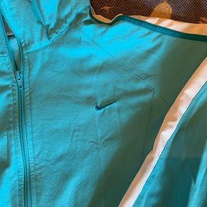 Blue Nike windbreaker